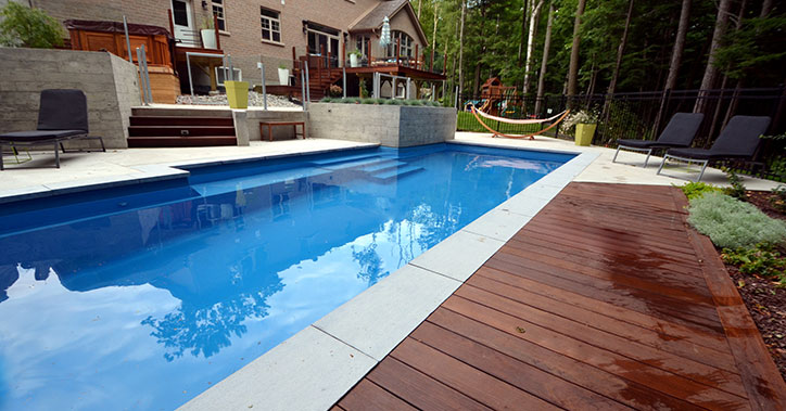 outdoor pool behind large house