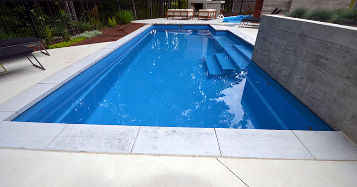 outdoor pool with light concrete surround