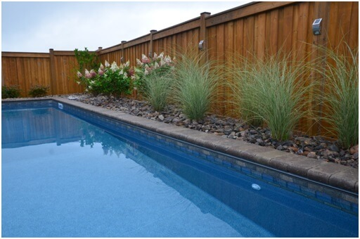pool edged with stones and cecorative grass