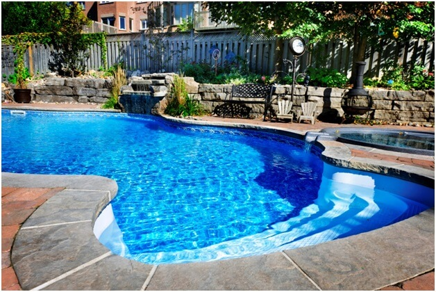 outdoor pool with stone surround
