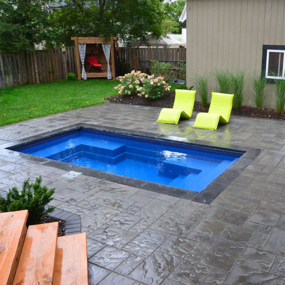 small wading pool with printed concrete surround