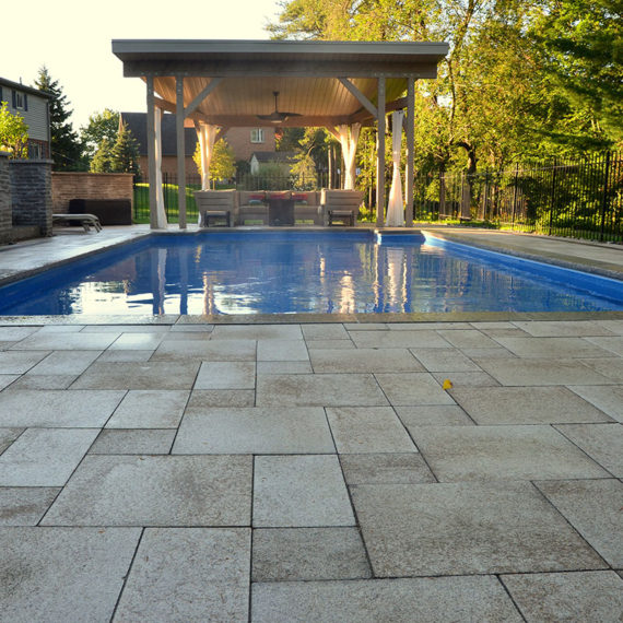 low-angle photo of rectangular pool with cabana