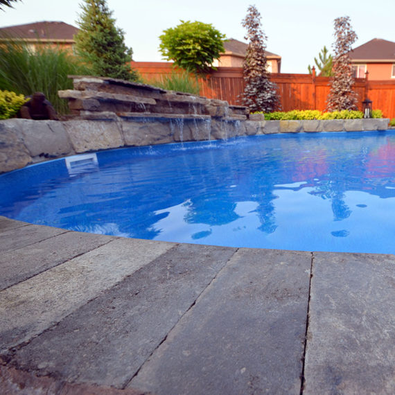 low angle image of pool with water feature