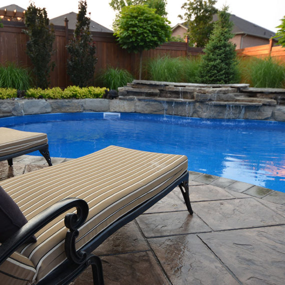 pool with printed concrete and water feature