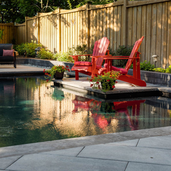 Wildwood Pool with red muskoka chairs. Blue Diamond Pools