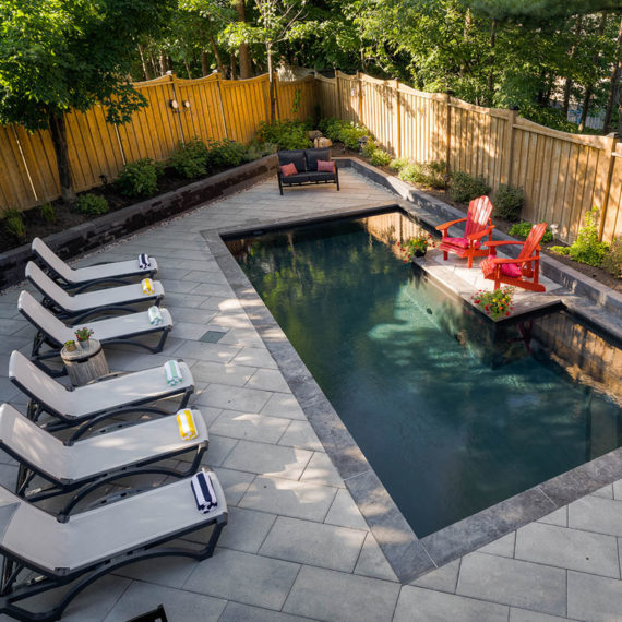 Wildwood Pool and Patio, Red Muskoka Chairs and lounge chairs