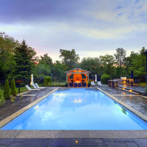 large rectangular pool surrounded by trees