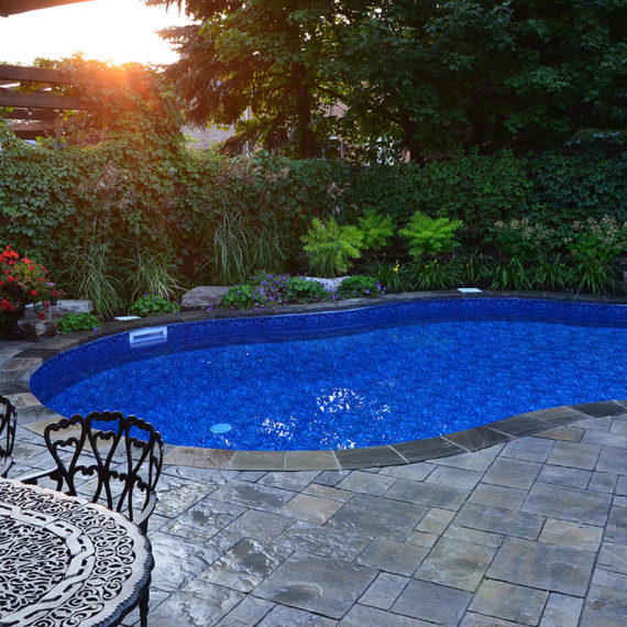 pool with stone surround and cast iron furniture