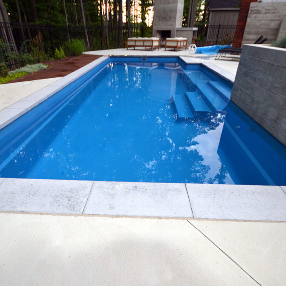 long outdoor pool with light-coloured surround