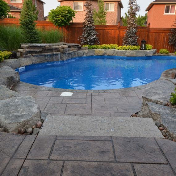 outdoor pool with stone water feature