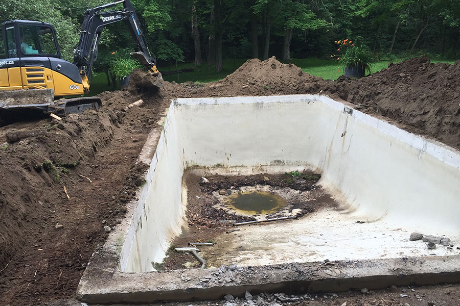 old concrete pool liner mid-renovation