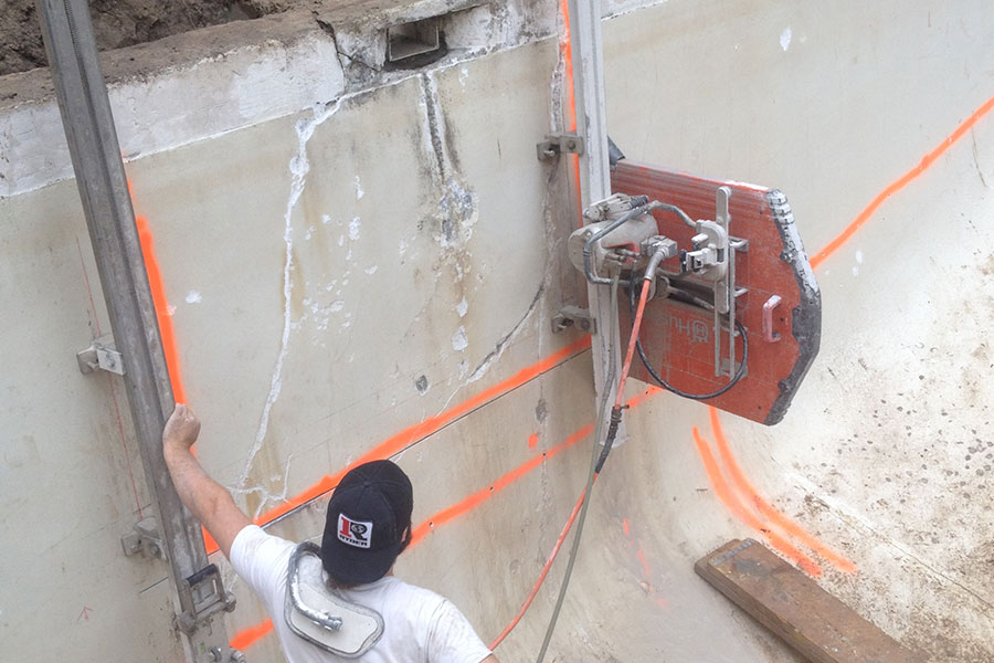 cracked concrete pool wall being cut