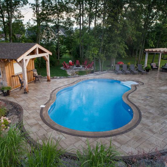 Full yard view of beautiful Red Oak backyard and pool